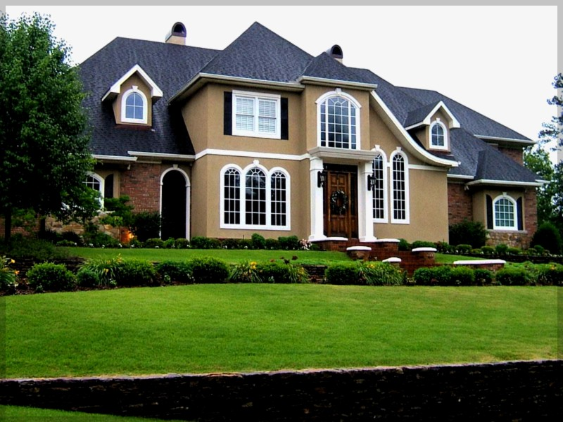 upscale residential home with nice landscaping that has a new roof by a residential roofing contractor in chicago