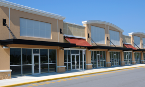 strip mall with a flat roof done by champion roofers